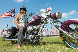 Bean're at the Field of Flags, a field of nearly 1,000 flags that tribute to the military near the Sturgis Buffalo Chip's west gate during the annual Black Hills Motorcycle Rally. SD, USA. August 7, 2014.  Photography ©2014 Michael Lichter.