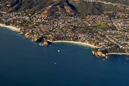 View of Three Arch Bay and Mussel Cove in South Laguna Beach, California, from the air looking northeast.