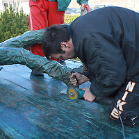 First ever life-size bronze statue of late Apple leader Steve Jobs is receiveing finishing touches in Budapest, Hungary on December 13, 2011. ATTILA VOLGYI