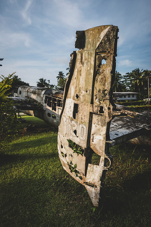 An American B-25 Mitchell bomber, which saw service during World War II, has stood since 1974 in front of the high school in Aitape, Papua New Guinea. In October 1944 it was declared war weary and soon abandoned in a bone yard at Tadji airfield, on the outskirts of Aitape. It's tail was missing when it was brought to the high school three decades later, so the tail from another B-25 that had been shot down at Dagua Airfield was attached to it.<br /><br />(July 19, 2017)