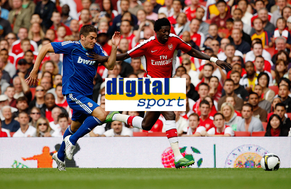 Photo: Richard Lane/Richard Lane Photography. Arsenal v Real Madrid. Emirates Cup. 03/08/2008. Arsenal's Emmanuel Adebayor is challenged by Real's Javier Garcia.