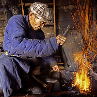 MONGOLIA. Auvsan, an 84-year old blacksmith, makes many of the critical buckles, bridles, and other metal tools needed in the Darhad Valley
