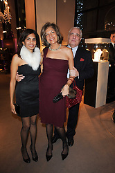 Left to right, DIVIA CADBURY, her mother VIMLA LALVANI and CONRAD ? at a party to celebrate the publication of Nathalie von Bismarck's book 'Invisible' held at Asprey, 167 New Bond Street, London on 9th December 2010.
