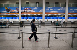 © Licensed to London News Pictures. 23/09/2019. Gatwick, UK. All Thomas Cook check-in desks at Gatwick Airport are closed after the travel firm collapsed overnight. The 178 year old travel operator has gone in to liquidation after rescue talks failed overnight. This will trigger the largest peacetime repatriation as more than 150,000 British holidaymakers will need to be brought home. Photo credit: Peter Macdiarmid/LNP