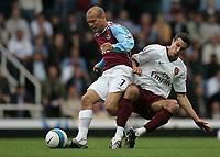 Photo: Lee Earle.<br /> West Ham United v Arsenal. The FA Barclays Premiership. 29/09/2007. Arsenal's Robin Van Persie (R) tackles Freddie Ljungberg.