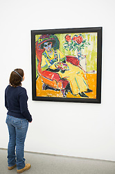 Woman looking at painting Bildnis Dodo by Ernst Ludwig Kirchner at Pinakothek Moderne art museum in Munich Germany