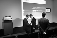 Credit Suisse staff preparing for a press conference to announce their annual results, in a conference room belong to the bank in central Zurich.