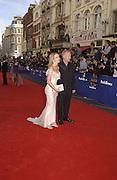 Les Dennis, Amanda Holden. TV Bafta Awards. 21 April 2002. © Copyright Photograph by Dafydd Jones 66 Stockwell Park Rd. London SW9 0DA Tel 020 7733 0108 www.dafjones.com