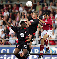 Fotball<br /> Foto: SBI/Digitalsport<br /> NORWAY ONLY<br /> <br /> Northampton v Leyton Orient<br /> Coca-Cola Football League 2<br /> Sixfields Stadium.<br /> 28/08/2004<br /> <br /> l-r Leyton Orients Brian Saah - Justin Miller and Northamptons  Scott McGleish all go for the ball.