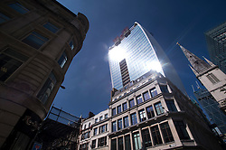 © London News Pictures. 04/09/2013. London, UK. The suns light reflects off 20 Finchurch Street in the financial district of central London. The building, which has been named unofficially the 'Walkie Talkie' building because of its shape, intensifies the suns light and reflects it onto the street below. There have been reports of damage to vehicles and local shops caused by the heat of the reflected light. Photo credit: Ben Cawthra/LNP