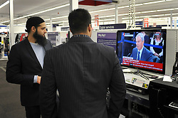 © London News Pictures. 2011/01/21 Store managers watch Tony Blair on television taking questions at The Iraq Inquiry today (Fri). Picture credit should read Stephen Simpson/LNP