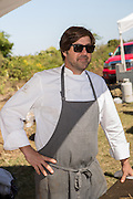 Chef Michael Lata during Cook it Raw outdoor BBQ event on Bowen's Island October 26, 2013 in Charleston, SC.