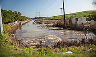 Sept 2, 2016 ,Worker dumping soda ash in contaminated floodwater next to the Honeywell chemical plant in Geismar, Louisiana