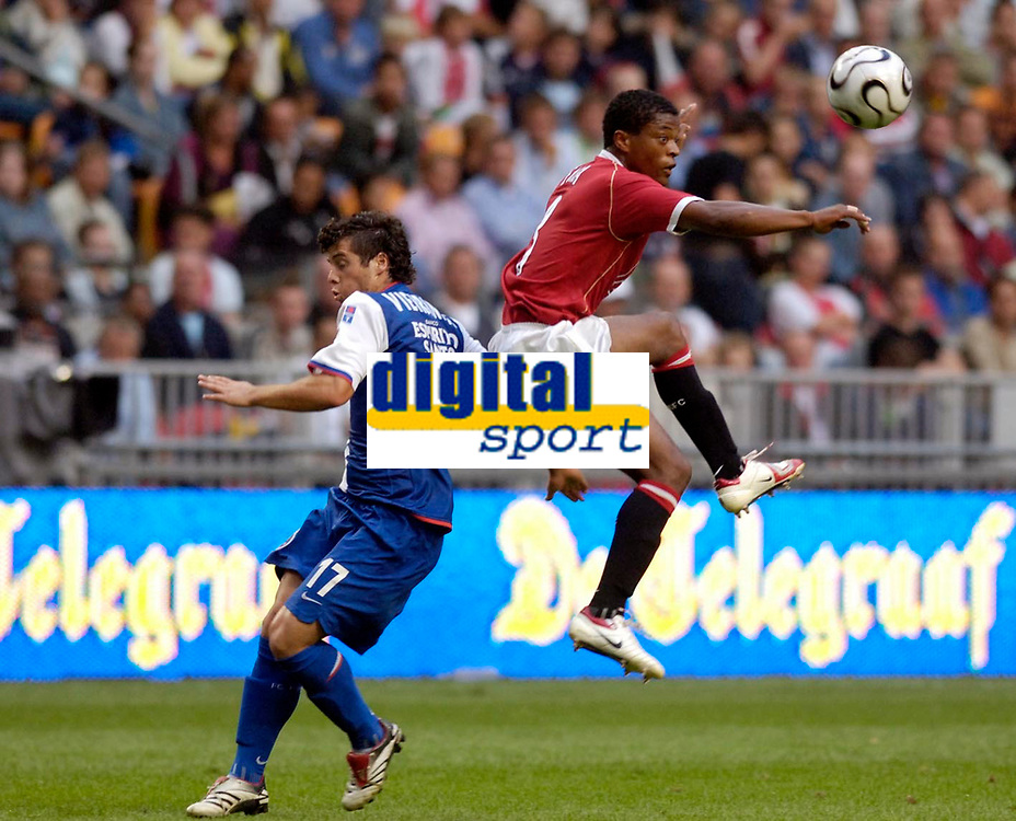Photo: Daniel Hambury.<br />Manchester United v FC Porto. Amsterdam Tournament. <br />04/08/2006.<br />Manchester's Patrice Evra and Porto's Vieirinha battle.