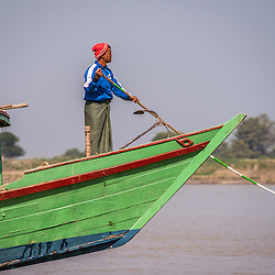 During this dry time of the year, the Chindwin (and the Irrawaddy River) are extremely shallow. Vessel captains hardly find a way through the mushrooming sandbanks, so one shipmates is constantly checking the depth of the water with his stick. Sometimes boats stuck on the sandbanks for several days and need to wait until another boat is pulling them out.<br /> <br /> The Chindwin River is the largest tributary of the Irrawaddy River and originates in the Kachin State of Myanmar and runs south before meeting the Irrawaddy River near the major city (not the capital) Mandalay. Due to low water levels, the Chindwin River is only accessible to larger river vessels during the monsoon season around late July and August and therefore is a much less explored area. Due to the lower number of boats and visitors, the areas around the Chindwin river are peaceful and unspoilt. Most of the river runs through beautiful scenic landscapes, mountain ranges and dense forests.