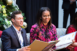 December 12, 2016 - Washington, DC, United States - On Monday, December 12, patients, families, and staff of Children's National Health System, were visited in the Main Atrium by, (l-r), Ryan Seacrest, and First Lady Michelle Obama, who read the holiday classic 'Twas the Night before Christmas to the audience. (Credit Image: © Cheriss May/NurPhoto via ZUMA Press)