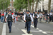 Police retreats near the Downing Street during a demonstration in Parliament Square in London on Wednesday, June 3, 2020, over the death of George Floyd, a black man who died after being restrained by Minneapolis police officers on May 25. Protests have taken place across America and internationally after a white Minneapolis police officer pressed his knee against Floyd's neck while the handcuffed black man called out that he couldn't breathe. The officer, Derek Chauvin, has been fired and charged with murder. (Photo/ Vudi Xhymshiti) near the Downing Street during a demonstration in Parliament Square in London on Wednesday, June 3, 2020, over the death of George Floyd, a black man who died after being restrained by Minneapolis police officers on May 25. Protests have taken place across America and internationally after a white Minneapolis police officer pressed his knee against Floyd's neck while the handcuffed black man called out that he couldn't breathe. The officer, Derek Chauvin, has been fired and charged with murder. (Photo/ Vudi Xhymshiti)