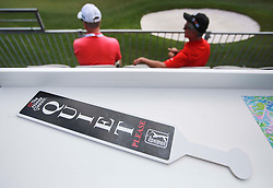 February 28, 2019 - Florida, U.S. - A ''Quiet Please'' sign rests on a tabletop as spectators follow play on the 10th hole of the first round of The Honda Classic Thursday, February 28, 2019 at the PGA National Resort & Spa in Palm Beach Gardens. (Credit Image: © Bruce R. Bennett/The Palm Beach Post via ZUMA Wire)