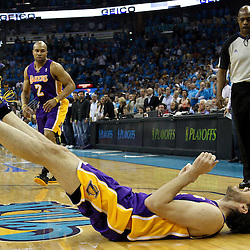 April 28, 2011; New Orleans, LA, USA; Los Angeles Lakers power forward Pau Gasol (16) reacts after being fouled during the first quarter in game six of the first round of the 2011 NBA playoffs against the New Orleans Hornets at the New Orleans Arena.    Mandatory Credit: Derick E. Hingle