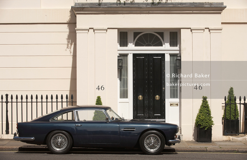 A classic Aston Martin DB5 is parked outside number 46, Chester Square SW1 in London's Belgravia. Such an example of great British design sits well outside this fine house on the western end of this Square laid out in 1840 by Thomas Cubitt and attracting the personalities of the day such as Mary Shelley, Violinist Yehudi Menuhin and Prime Ministers Harold Macmillan and Margaret Thatcher. Along with its sister squares Belgrave Square and Eaton Square, Chester Square is one of the most desirable addresses in London. The 1963 Aston Martin DB5 has a top speed of 141 mph (227 km/h) and was made famous by Sean Connery as James Bond in Goldfinger.  .
