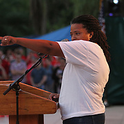 """Nadine Smith, Executive Director of Equality Floirda, speaks as people gather in Lake Eola park during the """"Marriage Equality Rally"""" at the Lake Eola bandshell in downtown Orlando, Florida on Thursday, June 27, 2013. Orlando's gay community and its supporters are celebrating the U.S. Supreme Court rulings on gay marriage and the Defense of Marriage Act (DOMA) reversal that constitutionally denied legally married gay couples federal benefits. (AP Photo/Alex Menendez)"""