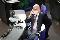 DEU, Deutschland, Germany, Berlin, 25.02.2021: Manfred Grund (CDU) am Telefon während der Plenarsitzung im Deutschen Bundestag.