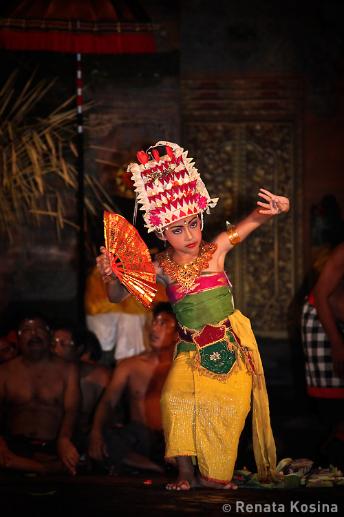 Young girl performs in Kecak dance in Batubulan village. Kecak is the most unique Balinese dance in which, instead of music, 100 men chant Cak. In the 1930s Ramayana story was added to the original trance dance.