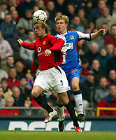 Photograph: Scott Heavey<br />Manchester United V Blackburn Rovers. 19/04/03.<br />David Beckham controls ahead of Vratislav Gresko during this FA Barclaycard Premiership match at Old Trafford.
