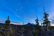 USA, Oregon, Mt. McKenzie Pass Scenic Byway, North and Middle Sister at twilight. Digital Composite, HDR