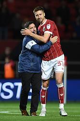 Bristol City manager Lee Johnson and Bristol City's Jens Hegeler celebrate after the Carabao Cup, third round match at Ashton Gate Stadium, Bristol.