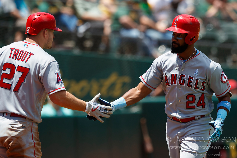 OAKLAND, CA - JUNE 17: Chris Young #24 of the Los Angeles Angels of Anaheim is congratulated by Mike Trout #27 after hitting a home run against the Oakland Athletics during the third inning at the Oakland Coliseum on June 17, 2018 in Oakland, California. The Oakland Athletics defeated the Los Angeles Angels of Anaheim 6-5 in 11 innings. (Photo by Jason O. Watson/Getty Images) *** Local Caption *** Chris Young; Mike Trout