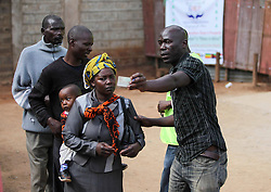 An election staff (R) guides voters at a polling station in Nairobi, Kenya, March 4, 2013. A total of 14.3 million Kenyan voters lined up to cast their ballots Monday morning to choose the country s next president, the first after disputed presidential elections tally stirred up violence five years ago, Monday March 4, 2013. Photo by Imago / i-Images...UK ONLY