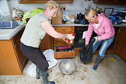 Victims of flooding at Toll Bar; South Yorkshire; July 2007; attempt to clean up the damage in their kitchen,