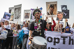 © Licensed to London News Pictures. 17/04/2019. London, UK. A man plays the drum as bereaved relatives and campaigners march to Westminster Bridge to demand action on knife crime in the capital. Photo credit: Rob Pinney/LNP