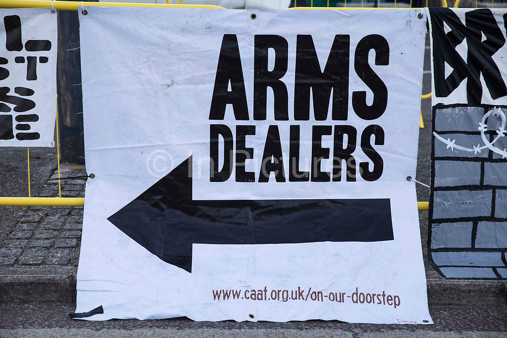 A Campaign Against The Arms Trade CAAT banner is pictured during Stop The Arms Fair protests outside ExCeL London as preparations for the DSEI 2021 arms fair continue on 8th September 2021 in London, United Kingdom. The third day of week-long Stop The Arms Fair protests outside the venue for one of the worlds largest arms fairs was themed around demilitarising education.