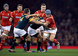 Wales' Scott Williams in action as he gets away from South Africa's Francois Venter and Ruan Combrinck (left) during the Autumn International match at the Principality Stadium, Cardiff.