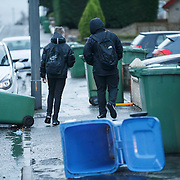 Storm Gertrude. Wheelie bins blown over in Garrowhill, Glasgow.  Picture Robert Perry 29th Jan 2016<br /> <br /> Must credit photo to Robert Perry<br /> FEE PAYABLE FOR REPRO USE<br /> FEE PAYABLE FOR ALL INTERNET USE<br /> www.robertperry.co.uk<br /> NB -This image is not to be distributed without the prior consent of the copyright holder.<br /> in using this image you agree to abide by terms and conditions as stated in this caption.<br /> All monies payable to Robert Perry<br /> <br /> (PLEASE DO NOT REMOVE THIS CAPTION)<br /> This image is intended for Editorial use (e.g. news). Any commercial or promotional use requires additional clearance. <br /> Copyright 2014 All rights protected.<br /> first use only<br /> contact details<br /> Robert Perry     <br /> 07702 631 477<br /> robertperryphotos@gmail.com<br /> no internet usage without prior consent.         <br /> Robert Perry reserves the right to pursue unauthorised use of this image . If you violate my intellectual property you may be liable for  damages, loss of income, and profits you derive from the use of this image.