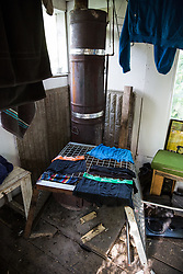 Sipson, UK. 5th June, 2018. A stove for heating water for hot showers is pictured at Grow Heathrow. Grow Heathrow is a squatted off-grid eco-community garden founded in 2010 on a previously derelict site close to Heathrow airport to rally support against government plans for a third runway and it has since made a significant educational and spiritual contribution to life in the Heathrow villages, which remain threatened by Heathrow airport expansion.