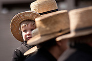 Amish boy during the Annual Mud Sale to support the Fire Department  in Gordonville, PA.
