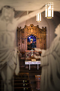 Etched glass depicting the crucifixion of Jesus Christ is seen against the sanctuary with baptismal font and altar at Gethsemane Lutheran Church on Tuesday, July 28, 2020, in St. Louis.  LCMS Communications/Erik M. Lunsford
