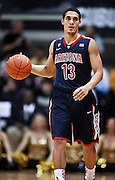 SHOT 1/21/12 6:19:56 PM - Arizona's Nick Johnson #13 dribbles the ball upcourt against Colorado during their PAC 12 regular season men's basketball game at the Coors Events Center in Boulder, Co. Colorado won the game 64-63..(Photo by Marc Piscotty / © 2012)