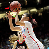 031414  Adron Gardner/Independent<br /> <br /> Shiprock Chieftain Aranxta Curley (20) lines up a field goal along the baseline during the 3A girls high school championship basketball against the Portales Rams at The Pit in Albuquerque Friday.