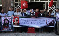 November 1, 2018 - Gaza City, Gaza Strip, Palestinian Territory - Palestinians take part a protest to show solidarity with the Leftist Legislator Khaleda Jarrar, held in Israeli jails in Gaza city on November 1, 2018  (Credit Image: © Mahmoud Ajjour/APA Images via ZUMA Wire)
