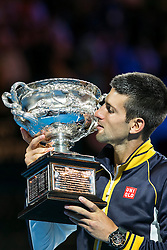 © Licensed to London News Pictures. 27/01/2013. Melbourne Park, Australia. Novak Djokovic kisses the winners trophy during the Mens Final between Novak Djokovic and Andy Murray of the Australian Open. Photo credit : Asanka Brendon Ratnayake/LNP
