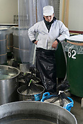 A member of staff at Nekka Shochu Distillery, Tadami, Fukushima, Japan, February 20, 2018. The Nekka shochu distillery was founded in July 2016 and at that time was the smallest shochu distillery in Japan. It makes shochu from locally-grown rice, and is helping support a local economy that has languished since the nuclear disaster of 2011.