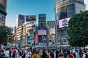 Shibuya Crossing in Tokyo is the world's single busiest pedestrian crossing, about 2500 people at a time. The intersection is heavily decorated by neon advertisements and giant video screens. What makes Shibuya Crossing so busy is Hachiko Exit of Shibuya Station. Shibuya Station hosts a major hub for shinkansen (bullet trains) and the beginning and end of two subways. Shibuya Station handles about 2 million people daily, the third busiest transportation hub in Tokyo. Shibuya is one of 23 city wards in Tokyo, but often refers to just the popular shopping and entertainment area found around Shibuya Station. Shibuya is a center for youth fashion and culture, the birthplace to many of Japan's fashion and entertainment trends.  The Tokyo urban area is home to over 38 million people.