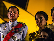 05 DECEMBER 2015 - BANGKOK, THAILAND: PRAYUTH CHAN-OCHA, the Prime Minister of Thailand, on the King's Birthday on Sanam Luang in Bangkok. Prayuth was the commander of the Thai army and seized power in a bloodless coup in 2014. Thais marked the 88th birthday of Bhumibol Adulyadej, the King of Thailand,  Saturday. The King was born on December 5, 1927, in Cambridge, Massachusetts. The family was in the United States because his father, Prince Mahidol, was studying Public Health at Harvard University. He has reigned since 1946 and is the world's currently the longest serving monarch in the world and the longest serving monarch in Thai history. Bhumibol, who is in poor health, is revered by the Thai people. His birthday is a national holiday and is also celebrated as Father's Day. He is currently hospitalized in Siriraj Hospital, recovering from a series of health setbacks.    PHOTO BY JACK KURTZ