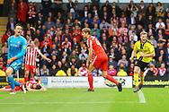 Burton Albion midfielder Jamie Allen (4) scores and celebrates during the EFL Sky Bet League 1 match between Burton Albion and Sunderland at the Pirelli Stadium, Burton upon Trent, England on 15 September 2018.