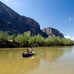Big Bend National Park, Texas: Day canoeists floating the Rio Grande River just outside the mouth of Santa Elena canyon in west Big Bend National Park. March 15, 2007  ©Bob Daemmrich/