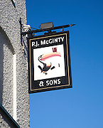 P.J McGinty Irish pub with toucan bird Guinness sign against blue sky, Ipswich, Suffolk, England